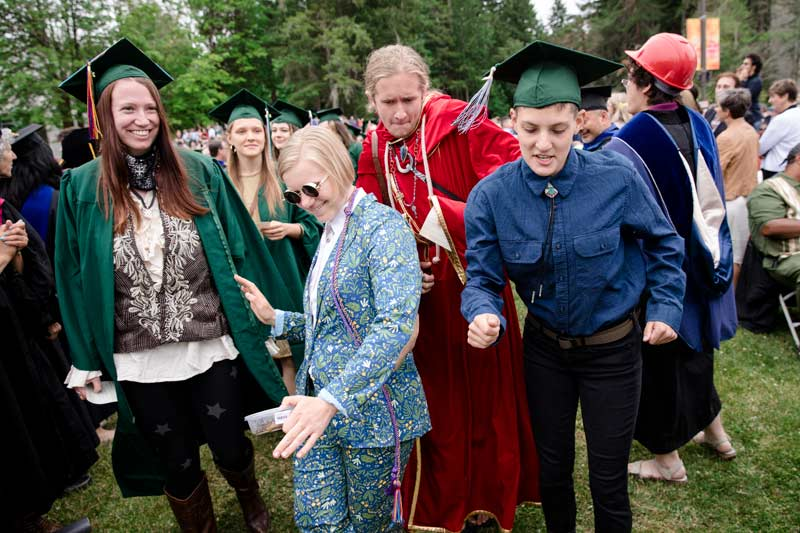 Greeners in non-traditional graduation garb dance during Evergreen's 2019 commencement ceremony.