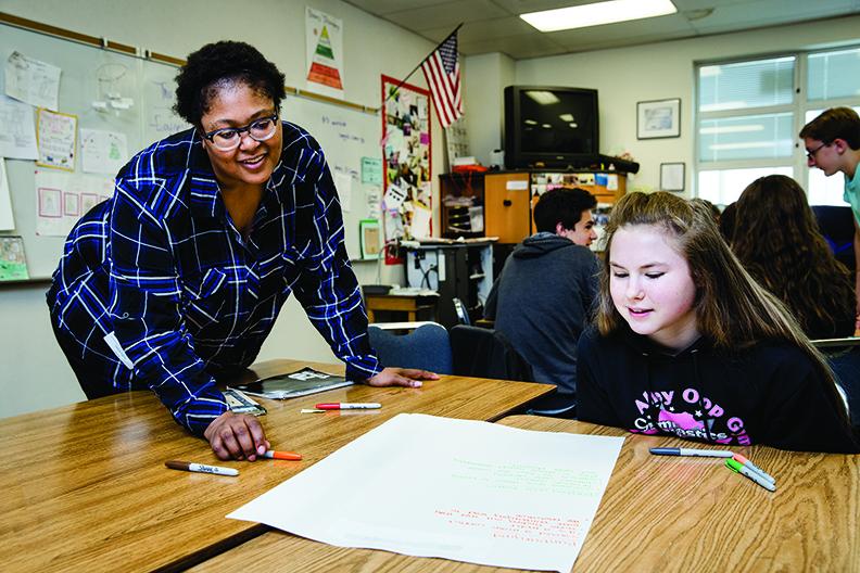 Hadiya Biglow, MiT 2018, working with a high school student in a classroom