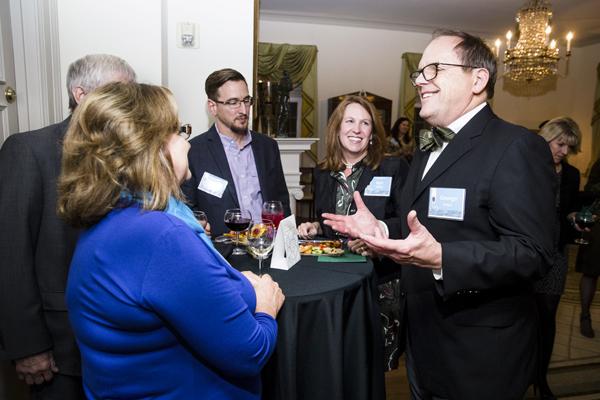 President George Bridges Talking with Guests