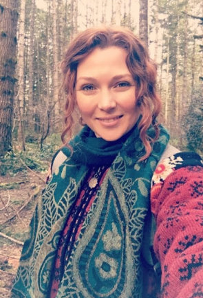 Woman smiling with forest background