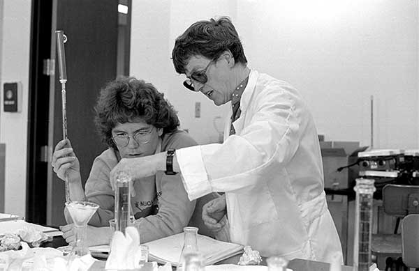 Kaye V. Ladd, right, collaborating in a chemistry lab.