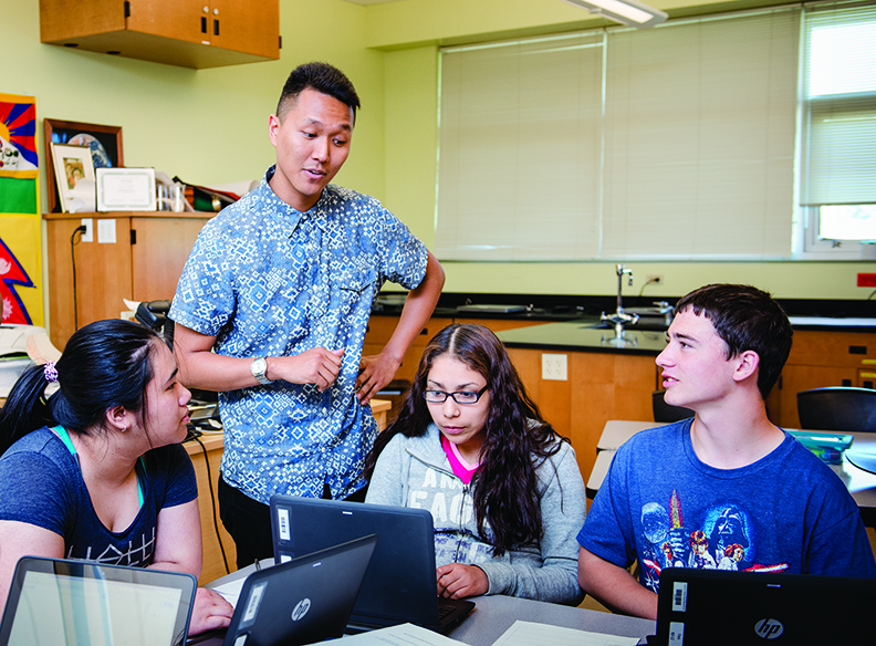 Tashi Langton, MiT 2015, working with three students in biology at a Tacoma high school