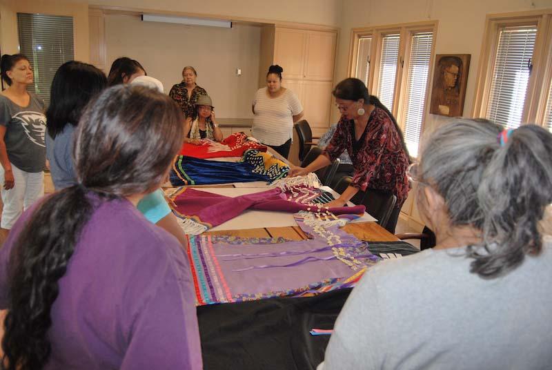 Roberta Kirk sharing five Plateau dresses with workshop participants