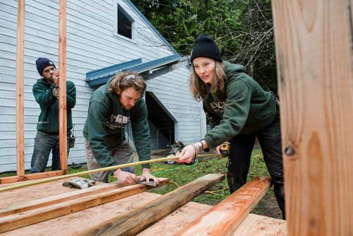 RAD workers build a shed for the campus