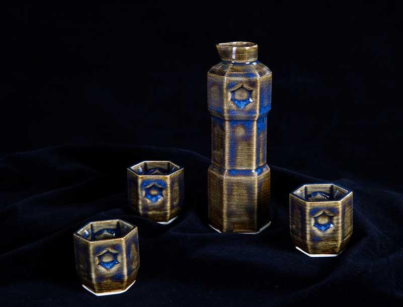 "Sake Set by Franny Lilliston and Val Shamma. High fire ceramics, 6""x2"". Donated by Bre Pettis '95."
