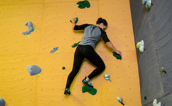 Student Climbing in the CRC climbing gym.