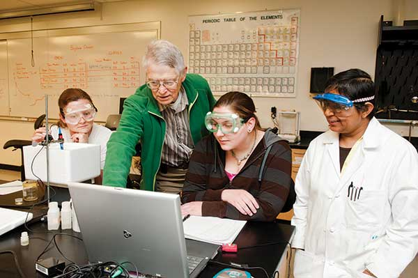 Fred Tabbutt running an experiment with Darshi Bopegaddera's Atoms, Molecules, and Reactions students in 2012.
