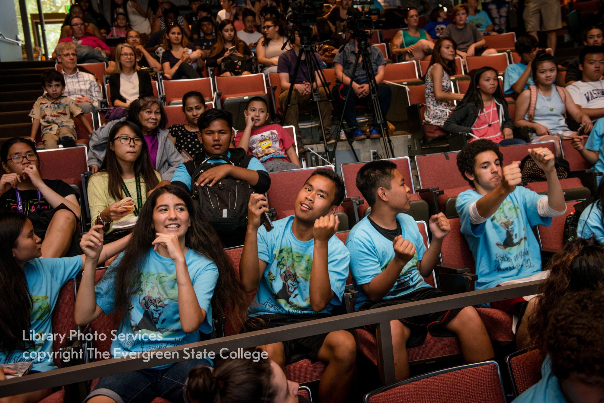 Upward bound students dancing in the auditorium
