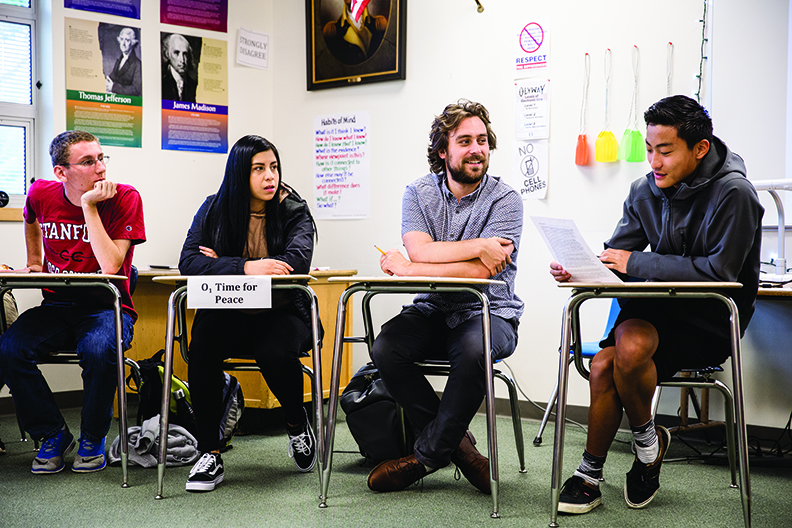 Hayden Zabel, MiT 2018, working with three high school students in a classroom