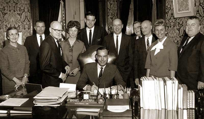 Gov. Daniel Evans signs the legislation creating Evergreen