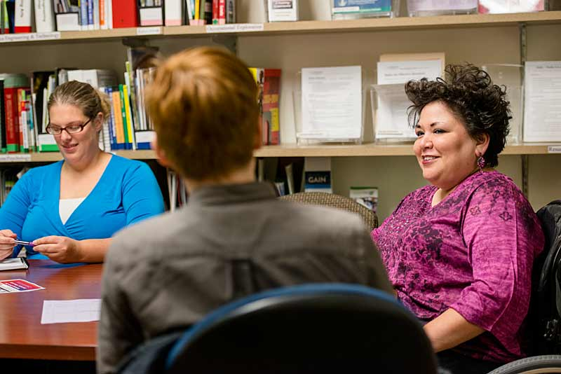 A Career Center Specialist meets with students at Job Club