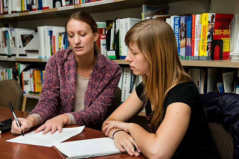 A Career Center advisor helps a student with her resume
