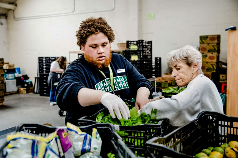 A student volunteering at the food bank
