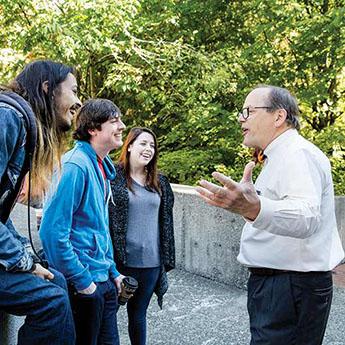 George Bridges speaks with students.