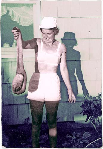 Vintage photo of a woman holding a geoduck by its siphon