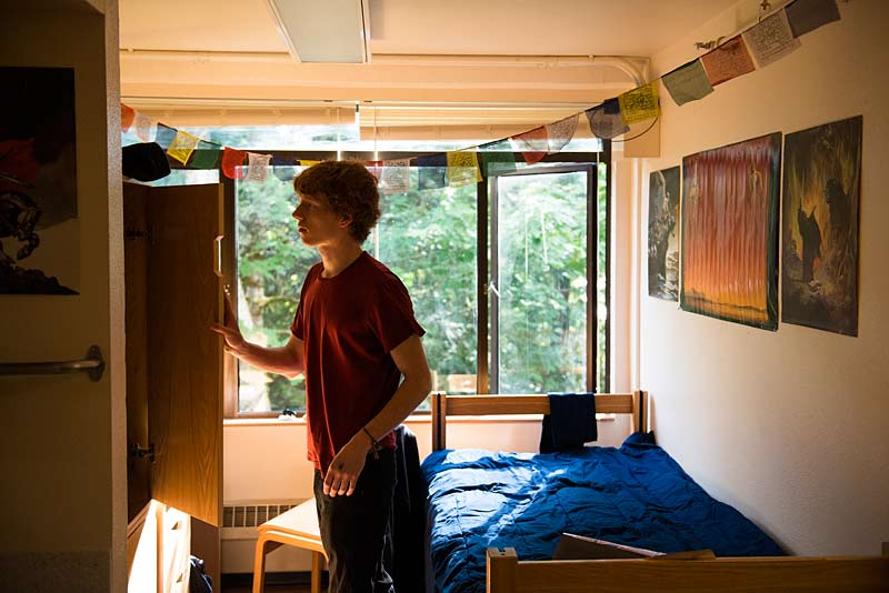 A new student moves into his dorm room.
