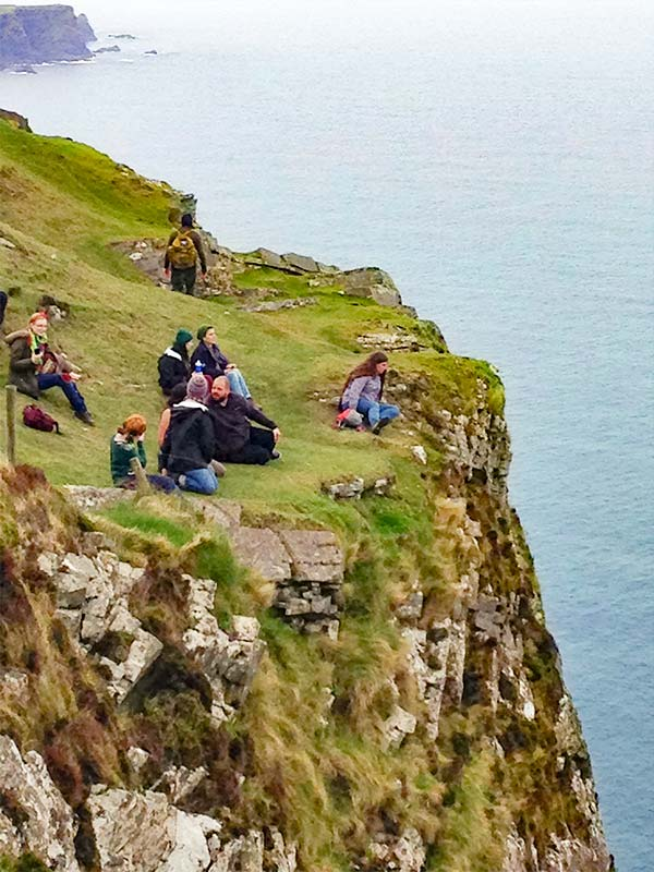 Students have lunch on the cliffsides of Ireland.