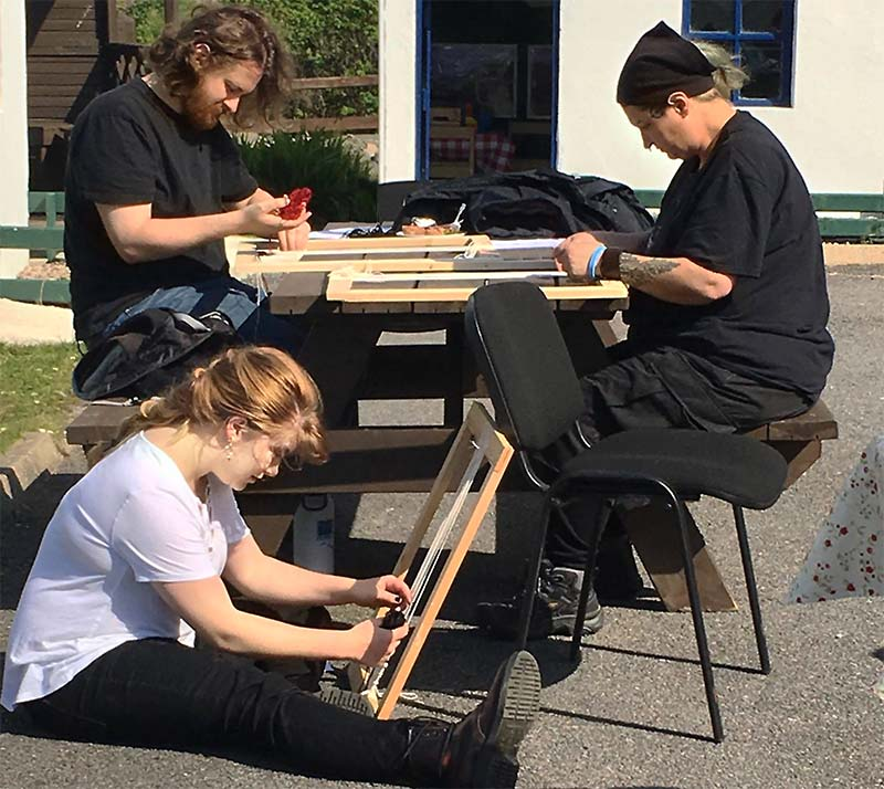 Students work in groups on a cultural weaving project in Ireland.