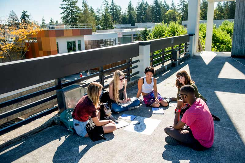 Students meet under the clock tower on the roof of the library building.
