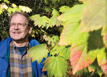 Rob Cole standing amongst leaves