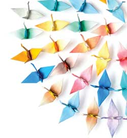 folded paper cranes in a spiral