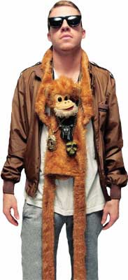 Macklemore wearing a toy monkey