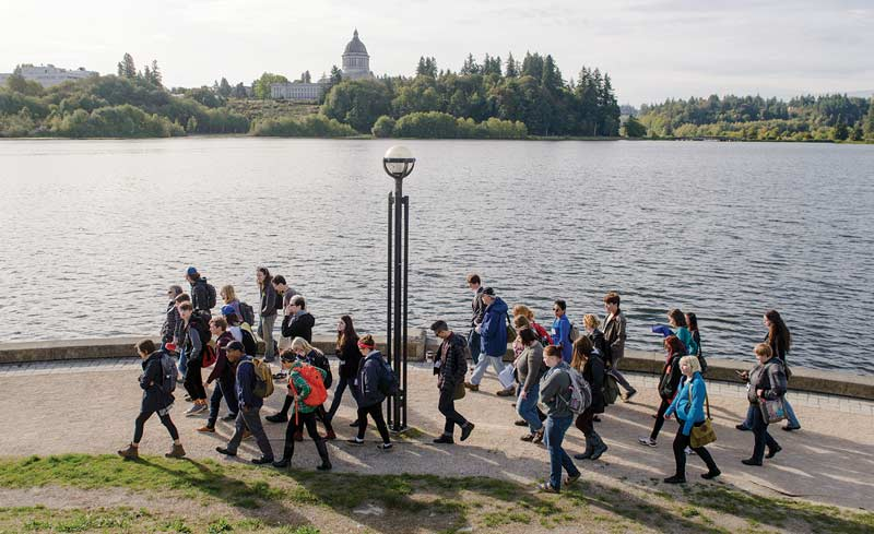 Photo of students walking by the water.
