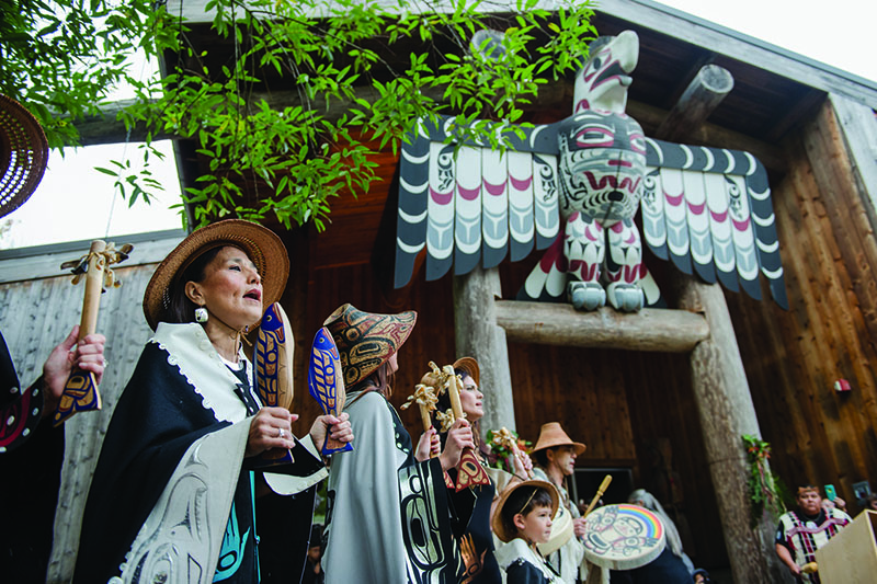 Git-Hoan Dancers from Southeast Alaska in front of the Evergreen Longhouse.