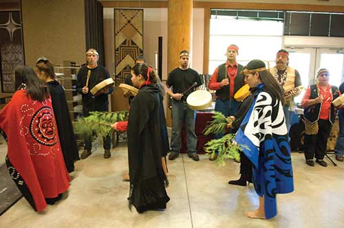 Photo of people at a celebration in the Longhouse.