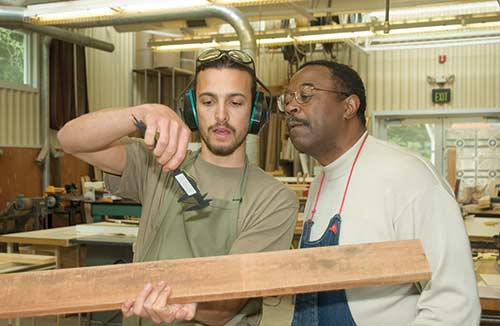 Woodworking Student with Les