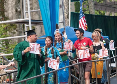 2012 grads protest the Keystone Pipeline during commencement.