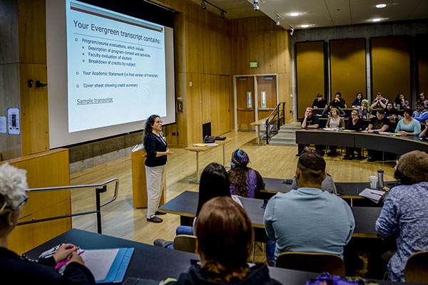 Students listen to a lecture on academic planning.