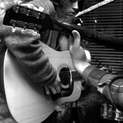 image of two people playing guitar