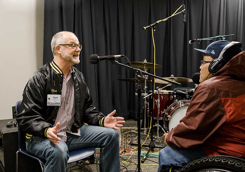 """Clark Gilman in the studio for the """"Voices Unite at KAOS"""" session."""