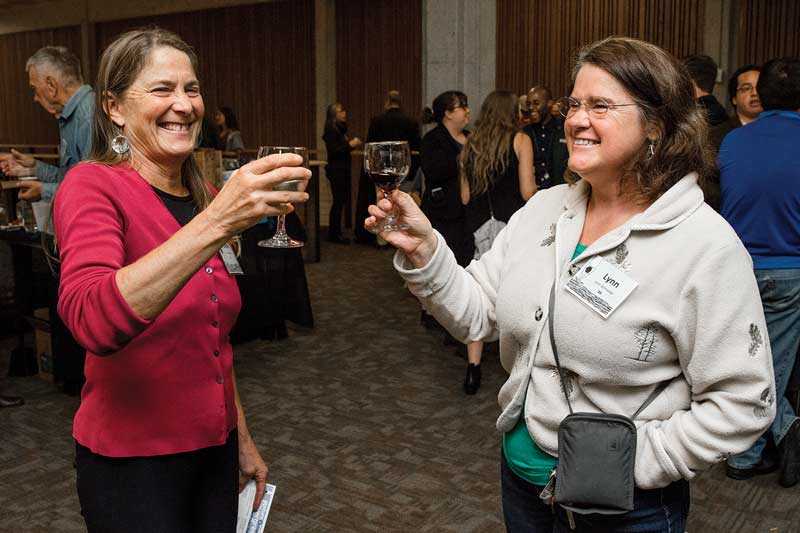 Attendees enjoy beverages produced by local alumni-owned businesses.