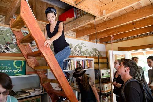 Student tour a Tiny Home