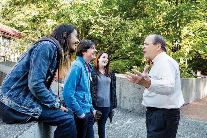 President George Bridges speaks with new students