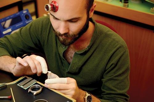 Nick Harris working on a watch