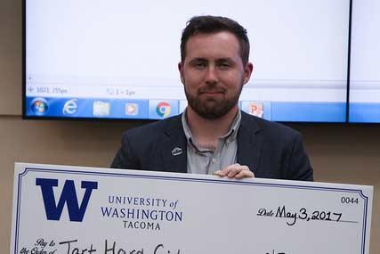 Nicholas Timm with award check