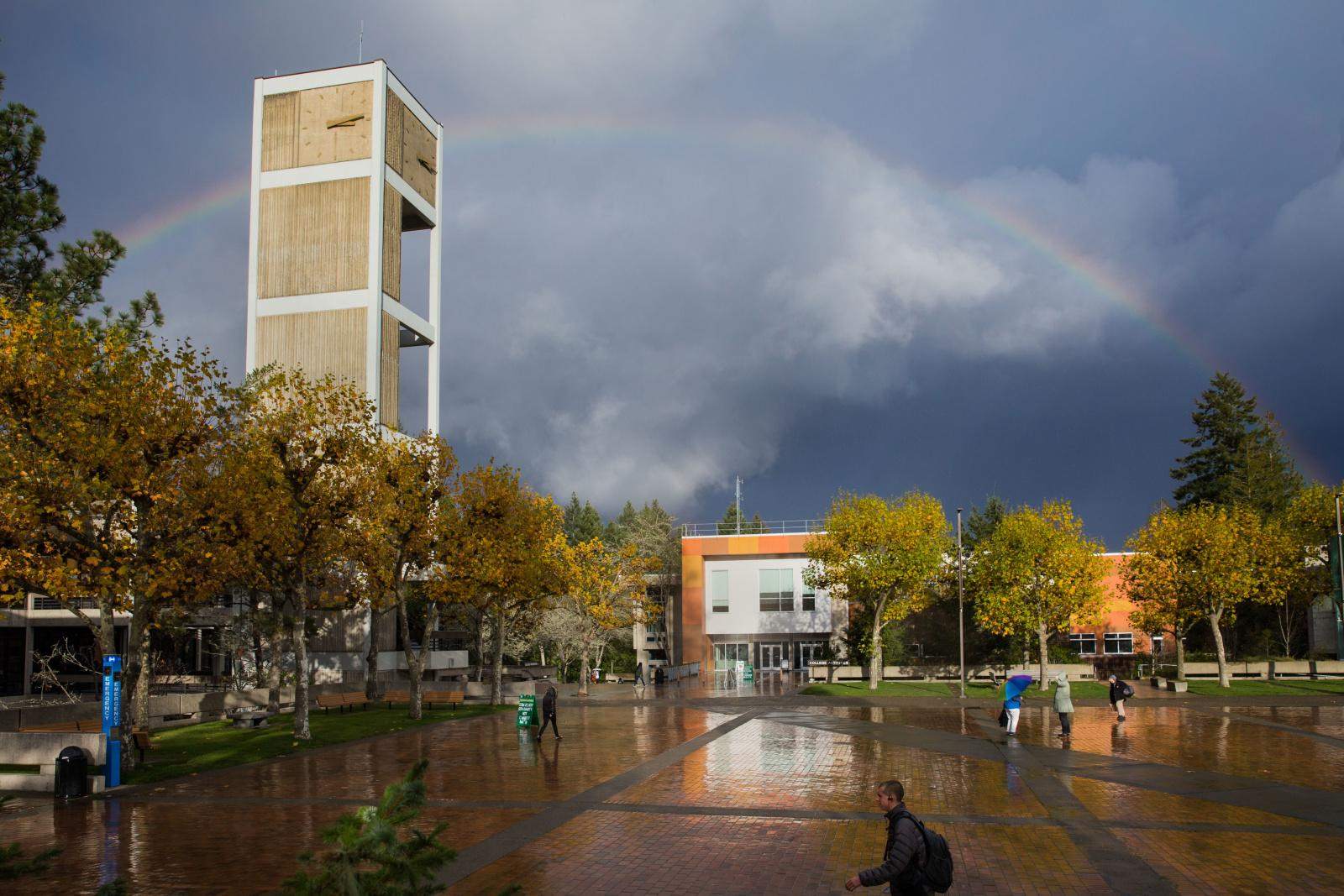 Evergreen Clock Tower with a Rainbow