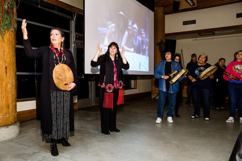 Tina Kuckkahn-Miller, J.D. (Ojibwe) (center) at the 2018 Longhouse Community Dinner.