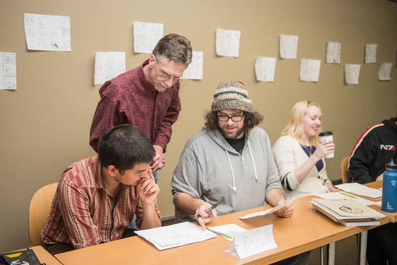 Steve Blakeslee overseeing two students