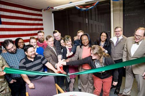 The ribbon cutting ceremony for the new Veteran's Lounge attended by President Bridges..