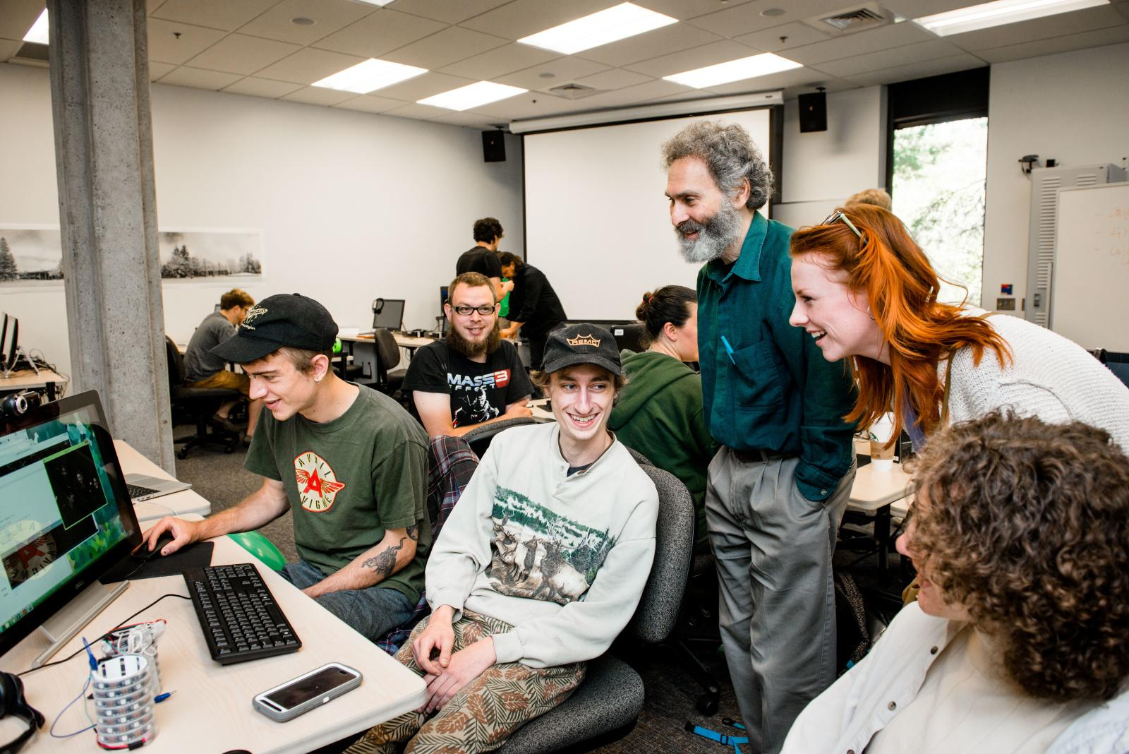 Evergreen faculty member Richard Weiss shares a laugh with students in August 2016. (photo: Shauna Bittle/Evergreen)