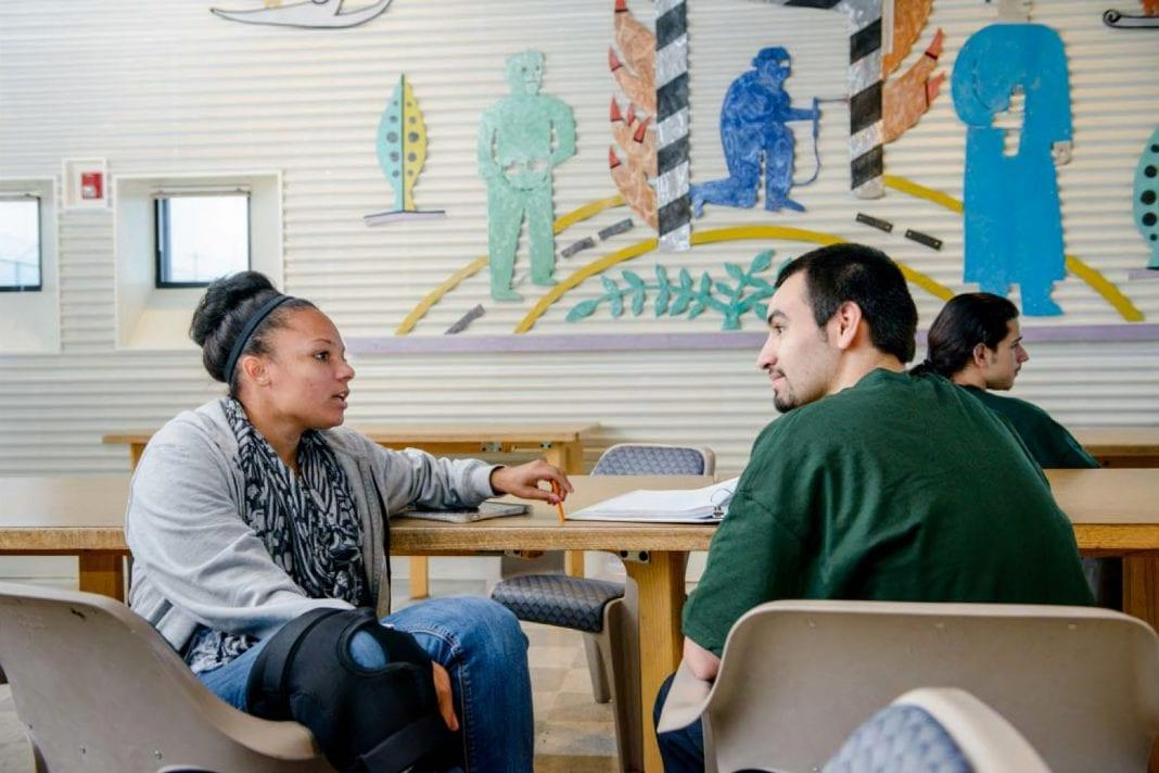 An image of two students talking during Evergreen's Gateways program