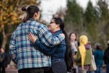 Evergreen community members offer each other support during a walk-out to protest the 2016 presidential election results.