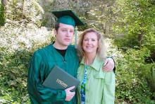 Edmond Lapine and his mother at graduation ceremony in 2008.
