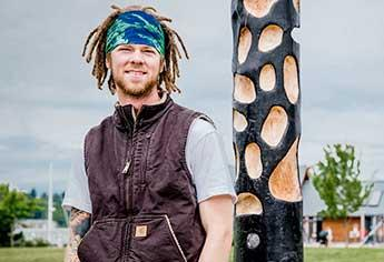 Grant Walker with his totem at Percival Landing in Olympia.
