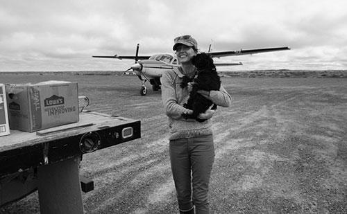Jenny Rice art photo airplane in back holding a dog