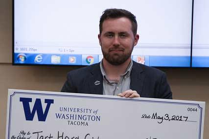 Nicholas Timm with award check